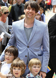 Alex James Photo - Blur bassist Alex James gives a big smile and hugs his sons Geronimo Artemis and Galileo on multicolor carpet at Empire Leicester Square for the UK premiere of Disney and Pixars Toy Story 3  The third installment in the Toy Story series has so far received positive reviews since its June release in North America and has proved popular in the toy and video game world with Mattel Wii Xbox 360 and PS3 all creating products based on the lovable film characters London UK 071810