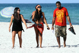Angela Simmons Photo - Angela Simmons wears a patterned bikini red striped sarong and red patterned bandana as she spends a day on the beach with friends during a birthday trip to Miami Angela celebrated her 24th birthday yesterday Miami Beach FL 19th September 2011