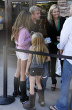 Anne Brown Photo - Actor Rick Schroder smiles and laughs with his wife Andrea Schroder and their two daughters Cambrie (pink hoodie) and Faith Anne (brown boots)  The family stood in line at the Malibu Cinema waiting to see a movie Los Angeles CA 071710