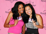 Enya Photo - Enya Flack and XiXi Yang attend the Bench Warmer Trading Card Signing Party held at The London West Hollywood hotel Bench Warmer International is the first trading card company to put attractive women on its cards which are traditionally reserved for sports stars Los Angeles CA 090210