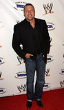 Paul MICHAEL Levesque Photo - WWE Superstar Triple H (aka Paul Michael Levesque) poses on the red carpet at the annual WWE SummerSlam kickoff party in association with the Muscular Dystrophy Association held at the Tropicana Bar inside the Hollywood Roosevelt Hotel Los Angeles CA 081310