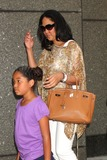 Aoki Lee Photo - Kimora Lee Simmons and Daughter Aoki Lee Simmons Arriving at the Matinee Performance of Shrek the Musical at the Broadway Theatre in New York City on 08-15-2009 Photo by Henry Mcgee-Globe Photos Inc 2009