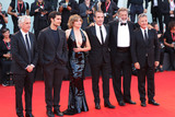 Jean Dujardin Photo - VENICE ITALY - AUGUST 30 (L-R) Alain Goldman Louis Garrel Emmanuelle Seigner Jean Dujardin Luca Barbareschi and Paolo Del Brocco walk the red carpet ahead of the JAccuse (An Officer And A Spy) screening during the 76th Venice Film Festival at Sala Grande on August 30 2019 in Venice Italy(Photo by Laurent KoffelImageCollectcom)
