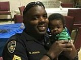 Police Officer Photo - In this 2016 photo provided by Trenisha Jackson her husband Baton Rouge Police Officer Montrell Jackson holds his son Mason at a Fathers Day event for police officers in Baton Rouge La Montrell Jackson and two other Baton Rouge law enforcement officers investigating a report of a man with an assault rifle were killed Sunday less than two weeks after a black man was fatally shot by police here in a confrontation that sparked nightly protests that reverberated nationwide (Courtesy of Trenisha Jackson via AP)