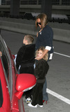 Brooklyn Beckham Photo - Fashion icon and former spice girl Victoria Beckham shephards her sons Brooklyn (l) and Romeo into JFK Airport enroute to LA