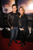 John Justin Photo - Actor John Leguizamo and wife Justine Maurer arriving at the The Lovely Bones premiere at the Paris Theatre on December 2 2009 in New York City