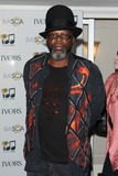Jazzie B Photo - Jazzie B arriving for the 59th Ivor Novello Awards at the Grosvenor House Hotel London 22052014 Picture by Alexandra Glen  Featureflash