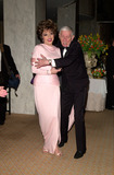 Aaron Spelling Photo - 12FEB2000  Actress JOAN COLLINS  producer AARON SPELLING at the Costume Designers Guild Awards in Beverly Hills Shes wearing a gown created by Nolan Miller who designed the costumes for TV series Dynasty                  Paul Smith  Featureflash