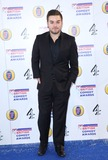 Alex Brooker Photo - Alex Brooker arriving for The British Comedy Awards 2013 held at Fountain Studios London 12132012 Picture by Henry Harris  Featureflash
