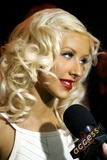 Chrisitina Aguilera Photo - Christina Aguilera carrying on an interview with Access Hollywood during her record release party at Marquee on August 15 2006 in New York City