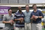Jay Feely Photo - From left  NY Giants place kicker Jay Feely NY Giants wide receiver Amani Toomer Indianapolis Colts quarterback Peyton Manning and his brother NY Giants quarterback Eli Manning during the kick off of Fantasy Football training camp at the South Street Seaport July 18 2005 in New York City