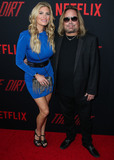 Vince Neil Photo - HOLLYWOOD LOS ANGELES CA USA - MARCH 18 Rain Andreani and musician Vince Neil arrive at the Los Angeles Premiere Of Netflixs The Dirt held at ArcLight Cinemas Hollywood on March 18 2019 in Hollywood Los Angeles California United States (Photo by Xavier CollinImage Press Agency)
