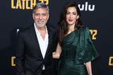 Amal Clooney Photo - HOLLYWOOD LOS ANGELES CALIFORNIA USA - MAY 07 Actor George Clooney and wifebarrister Amal Alamuddin Clooney (wearing an Oscar de la Renta dress) arrive at the Los Angeles Premiere Of Hulus Catch-22 held at the TCL Chinese Theatre IMAX on May 7 2019 in Hollywood Los Angeles California United States (Photo by Xavier CollinImage Press Agency)