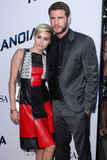 Miley Cyrus Photo - (FILE) Miley Cyrus and Liam Hemsworth Split LOS ANGELES CALIFORNIA USA - AUGUST 08 Singer Miley Cyrus and boyfriendactor Liam Hemsworth arrive at the Los Angeles Premiere Of Relativity Medias Paranoia held at the Directors Guild of America Theatre on August 8 2013 in Los Angeles California United States (Photo by Xavier CollinImage Press Agency)