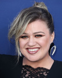 Yves Saint-Laurent Photo - LAS VEGAS NEVADA USA - APRIL 07 Singer Kelly Clarkson wearing an Alexander McQueen dress Yves Saint Laurent earrings and Balmain shoes arrives at the 54th Academy Of Country Music Awards held at the MGM Grand Garden Arena on April 7 2019 in Las Vegas Nevada United States (Photo by Xavier CollinImage Press Agency)