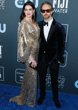 Ann Hathaway Photo - SANTA MONICA LOS ANGELES CALIFORNIA USA - JANUARY 12 Anne Hathaway and Adam Shulman arrive at the 25th Annual Critics Choice Awards held at the Barker Hangar on January 12 2020 in Santa Monica Los Angeles California United States (Photo by Xavier CollinImage Press Agency)