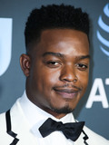 THOM BROWN Photo - SANTA MONICA LOS ANGELES CA USA - JANUARY 13 Actor Stephan James wearing a Thom Browne tux and boots with a Montblanc watch arrives at the 24th Annual Critics Choice Awards held at the Barker Hangar on January 13 2019 in Santa Monica Los Angeles California United States (Photo by Xavier CollinImage Press Agency)