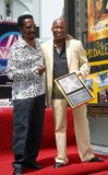 Ike Turner Photo - - Director John Singleton Honored with Star on the Hollywood Walk of Fame - Hollywood Blvd Hollywood CA - 08262003 - Photo by Clinton H Wallace  Ipol  Globe Photos Inc 2003 Ike Turner and John Singleton