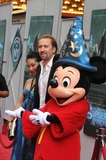 Alice Kim Photo - Sorcerers Apprentice New Amsterdam Theater ny 07-06-2010 Photo by Ken Babolcsay - Ipol-Globe Photo 2010 Nicolas Cage and Wife Alice Kim with Mickey Mouse