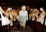 Albert Hall Photo - A14640NO UK RIGHTS UNTIL 30042004054522 03302004The Queen walks past dancers from the English National Ballet during a visit to the Royal Albert Hall in London marking the end of an 8 year restoration program The overhaul of one of Londons best known landmarks has cost 70 million and includes two new foyers revamped seating in the stalls and circle as well as better access for disabled patrons