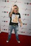 Steel Panther Photo - Adam Saaks Flagship Store Opening Adam Saaks-melrose Ave Los Angeles CA 10102010 Michael Starr of Steel Panther Photo Clinton H Wallace-ipol-Globe Photos Inc