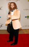 GEICO CAVEMAN Photo - the 17th Annual Night of 100 Stars Beverly Hills Hotel Beverly Hills CA 02-25-2007 Geico Caveman and Guest Photo Clinton H Wallace-photomundo-Globe Photos Inc
