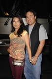 Ming-Na Wen Photo - Ming Na Wen and Eric Michael Zee During the Adult Swim Robot Chicken Skate Party Bus Tour Held at Skateland on August 1 2009 in Northridge San Fernando Valley Los Angeles Photo Michael Germana - Globe Photos Inc