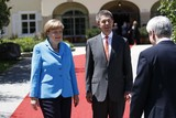 Angela Merkel Photo - German Chancelor Angela Merkel and Her Husband Joachim Sauer Welcome Guests at the G7 Summit at Elmau Castle Near Garmisch-partenkirchen Germany on 07 June 2015 Photo Alec Michael