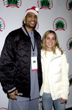 Allan Houston Photo - New York Giants Michael Barrow Hosted 2nd Annual Nynj Sports Celebrity Carnival at Madison Square Gardenplay by Play in New York City 12152003 Photo Byjohn KrondesGlobe Photos Inc 2003 Allan Houston (New York Knicks) and Becky Hammon