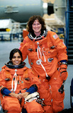 Kalpana Chawla Photo - JSC2001-02458 (18 September 2001) --- Astronauts Kalpana Chawla (seated) and Laurel B Clark both STS-107 mission specialists are photographed prior to a training session in the Space Vehicle Mockup Facility at the Johnson Space Center (JSC) Chawla and Clark are wearing training versions of the full-pressure launch and entry suit SUPPLIED BYNASAGLOBE PHOTOS INCK28788