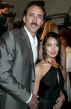 Alice Kim Photo - Donatella Versace Host Cocktail Party to Celebrate the Re-opening of the Versace Boutique on Fifth Avenue  New York City 02-07-2006 Photo Sonia Moskowitz-Globe Photos Inc 2006 Nicolas Cage Alice Kim