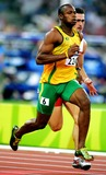 Asafa Powell Photo - Asafa Powell Jamaica Mens 100m Athens Greece Di2546 8222004 Athens 2004 Olympic Games Photo ByallstarGlobe Photos Inc 2004