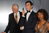 Gloria Hendry Photo - Madame Tussauds Hollywood Reveal All Six James Bonds in Wax with Special Guest George Lazenby Madame Tussauds-hollywood Hollywood CA 12152015 George Lazenby Posing with a Wax Figure of His James Bond Character Along with Bond Girl Gloria Hendry Clinton H Wallacephotomundo InternationalGlobe Photos Inc
