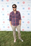 Adam Pally Photo - The Ovarian Cancer Research Funds Super Saturday 17 Novas Ark Project Water Mill NY July 26 2014 Photos by Sonia Moskowitz Globe Photos Inc 2014 Adam Pally