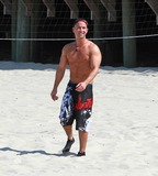 Mike The Situation Sorrentino Photo - August 2 2010 Mike The Situation Sorrentino Pauly D Vinny and Ronnie play volleyball on the beach as they film scenes for season 3 of the Jersey Shore in Seaside Heights New Jersey